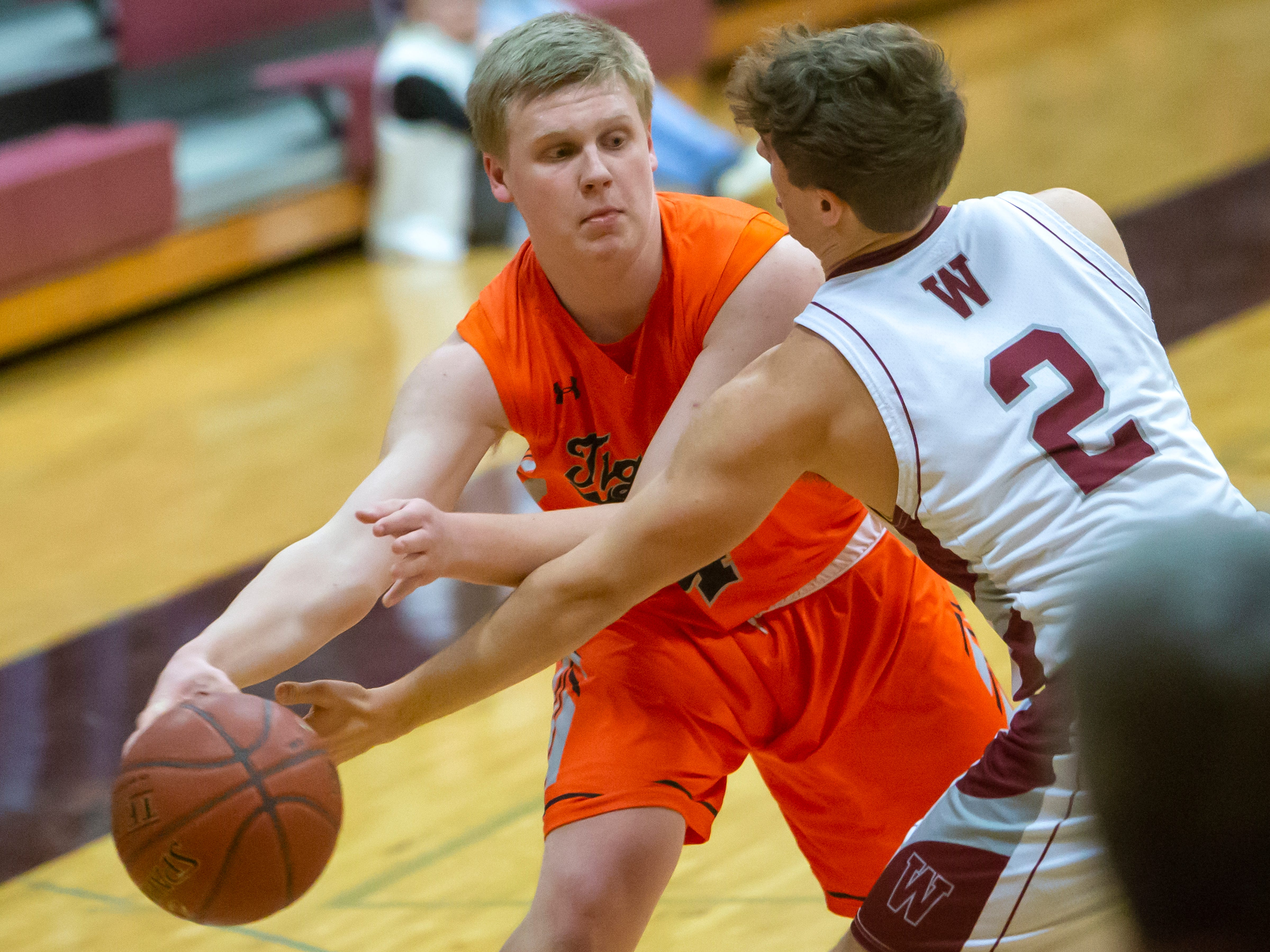 Ripon's Hunter Auchtung passes around Winneconne's Austin Hecker at Winneconne High School on Thursday, January 24, 2019.