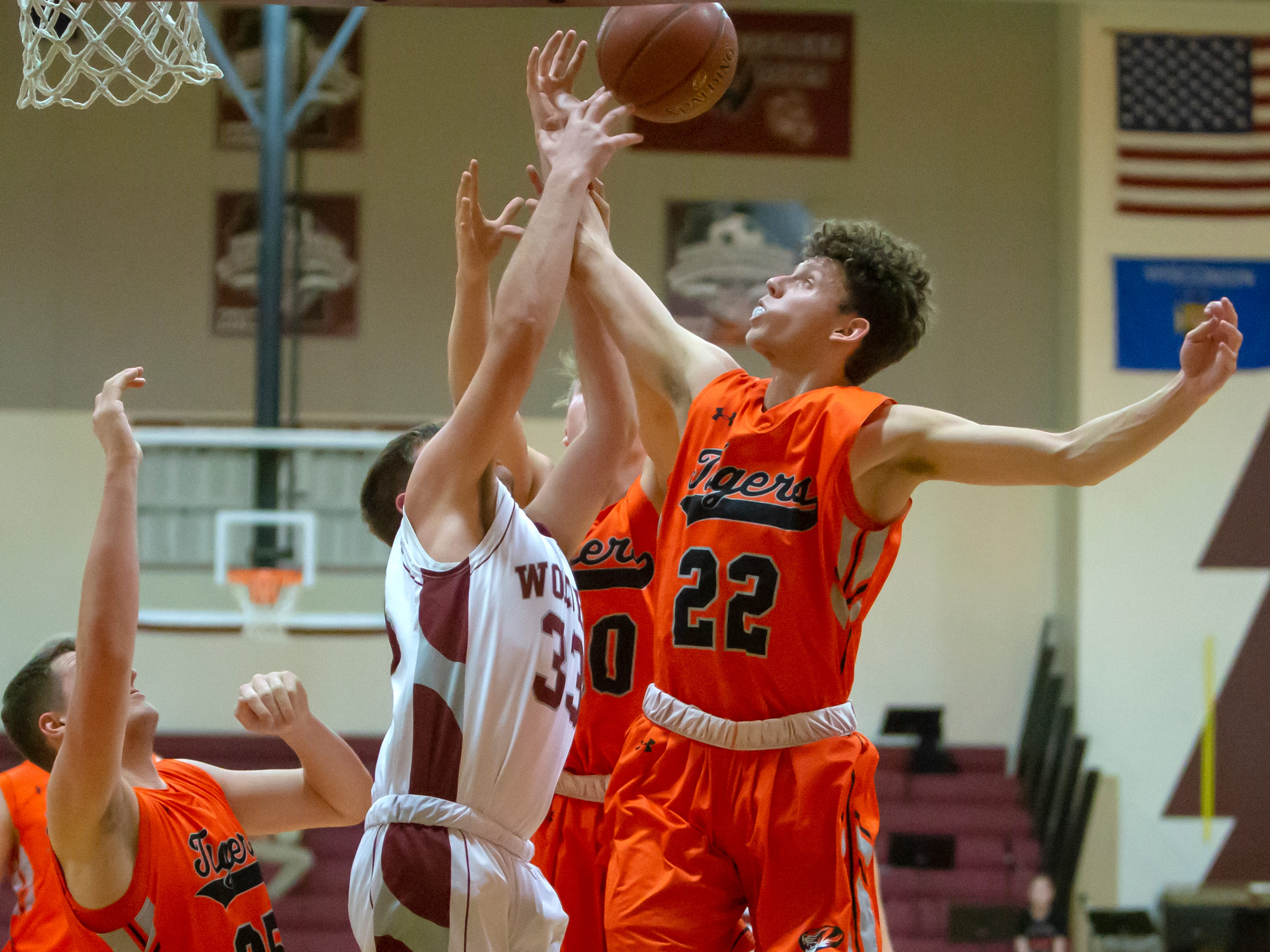 Ripon's Max Beuthin and Winneconne's Andrew Jensen go up for the rebound ball at Winneconne High School on Thursday, January 24, 2019.