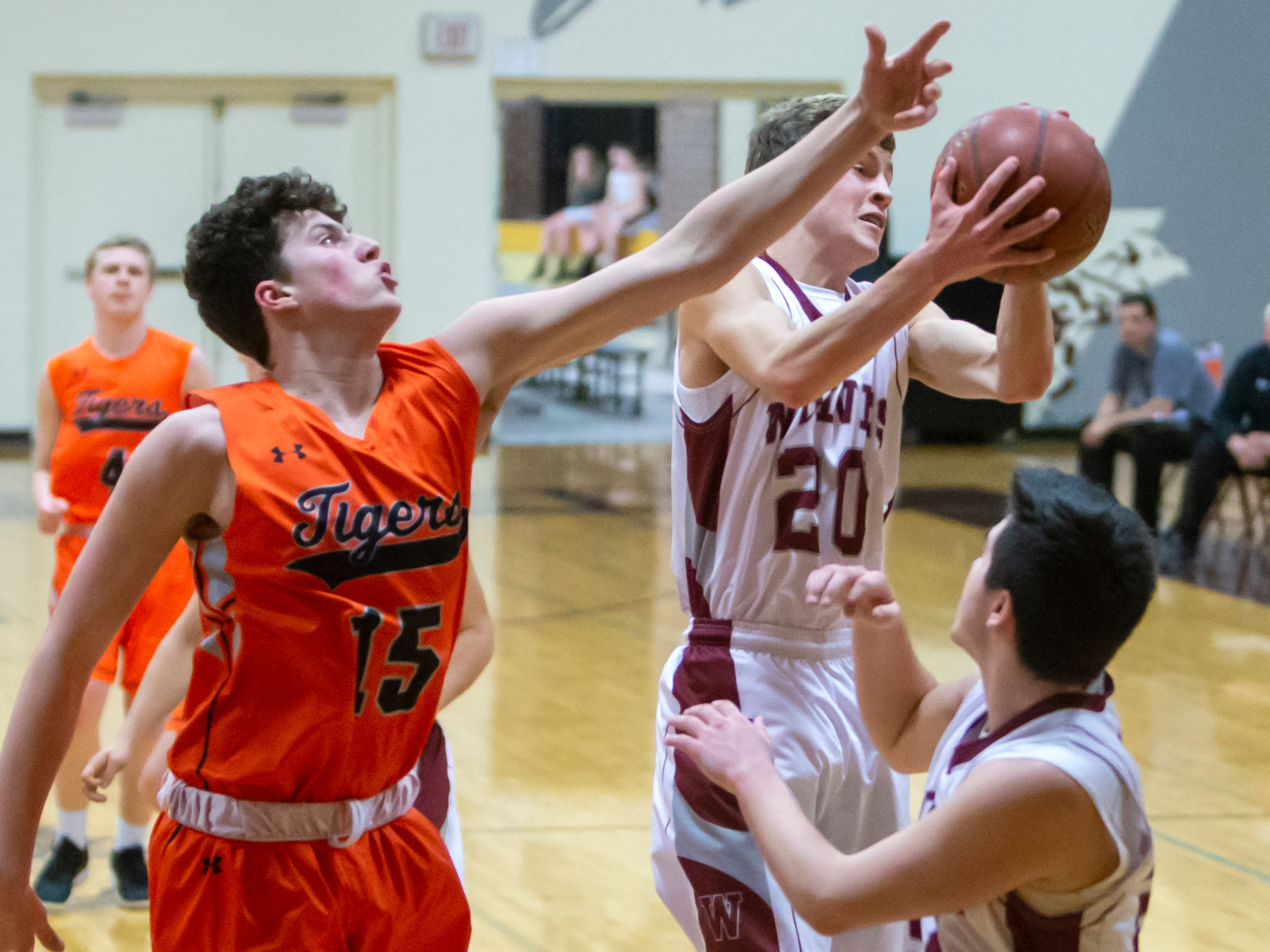 Winneconne's Trenton Hanseder comes down with a rebound at Winneconne High School on Thursday, January 24, 2019.