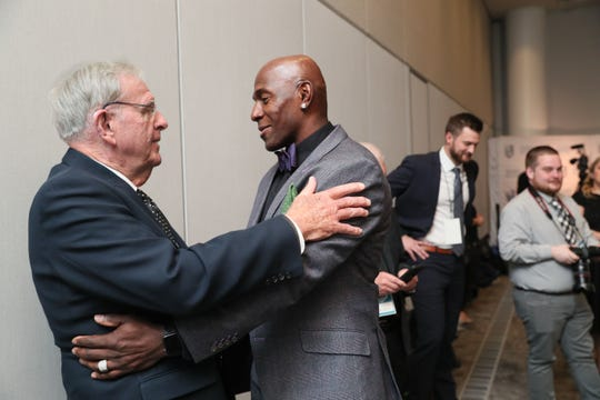 Former Green Bay Packers general manager Ron Wolf (left) greets former Packers player Donald Driver before the Wisconsin Athletic Hall of Fame ceremony Thursday night at Discovery World.