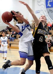 Cathedral City's Nina Wallace goes up for a shot as Yucca Valley's Loryn Brimhall defends in Cathedral City on Thursday, January 24, 2019.