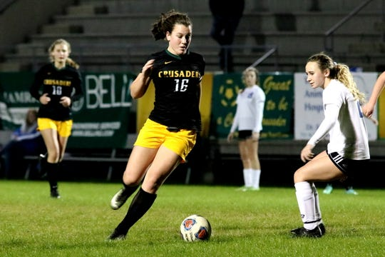 Catholic senior Caroline Buer dribbles during a match against Freeport earlier this season. The Crusaders were 2-0 against Freeport in the 2018 -19 regular season.