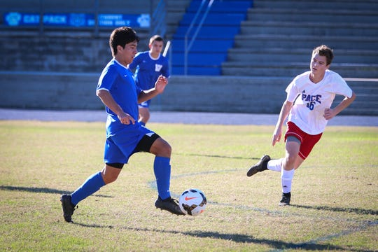 Washington junior Christian Garcia-Vasquez dribbles in a game against Pace earlier this season. Garcia-Vasquez is the team's leading scoer.