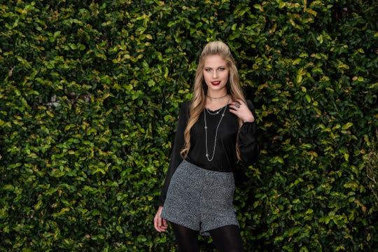 Bella Magazine's February model Lauren Rawls.Shopping ListHigh waists and everything that glitters are both on trend in winter 2019. Combine both in these simple yet chic high-waisted shorts ($48) and black silk V-neck top, both by Lee Tracy. Let the shimmering shorts be the star by teaming with black tights and booties and sparkling silver jewelry.