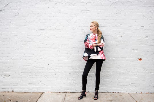 Bella Magazine's February model Lauren Rawls.Shopping List:Florals of every variety are sprouting up in fashion this winter and spring, and retro looks are a runway trend. Go big or go home in this jacket by WHYdress ($128). Team with sleek black leggings by Liverpool ($79).