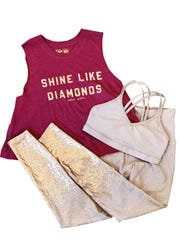 Alloy Ombre high waisted midi legging, $100, Pure Pilates; Alloy double back bra, $68, Pure Pilates; Spiritual gangster Diamond Crop tank, $48, Pure Pilates; Teleties, $12, Indigeaux Denim Bar & Boutique.