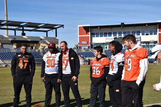 The six Senior Bowl players who visited Blue Wahoos Stadium Friday for a first-ever event with the Blue Wahoos and Studer/55 Community Athletics and the Reese's Senior Bowl.