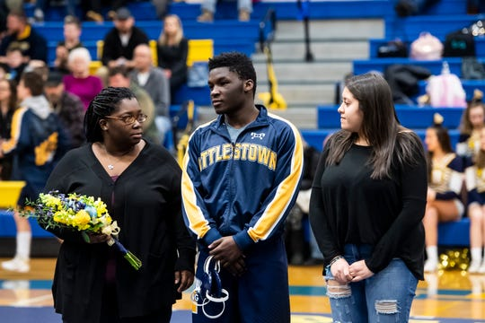 Littlestown's Carl Harris is honored on senior night prior to a match against Bermudian Springs in Littlestown Thursday, January 24, 2019. The Bolts fell 62-12.