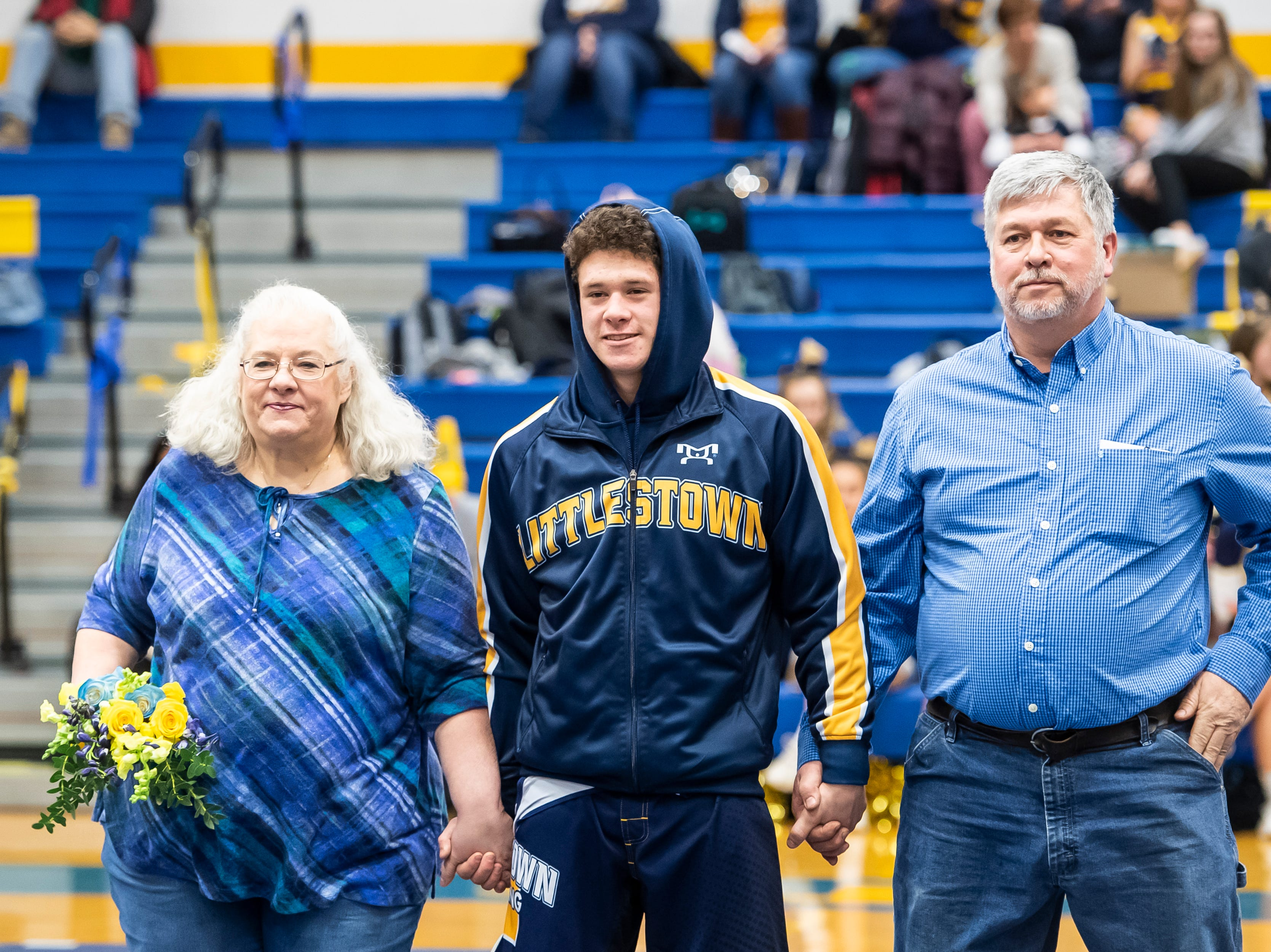 Littlestown's Jason Penton is honored on senior night prior to a match against Bermudian Springs in Littlestown Thursday, January 24, 2019. The Bolts fell 62-12.