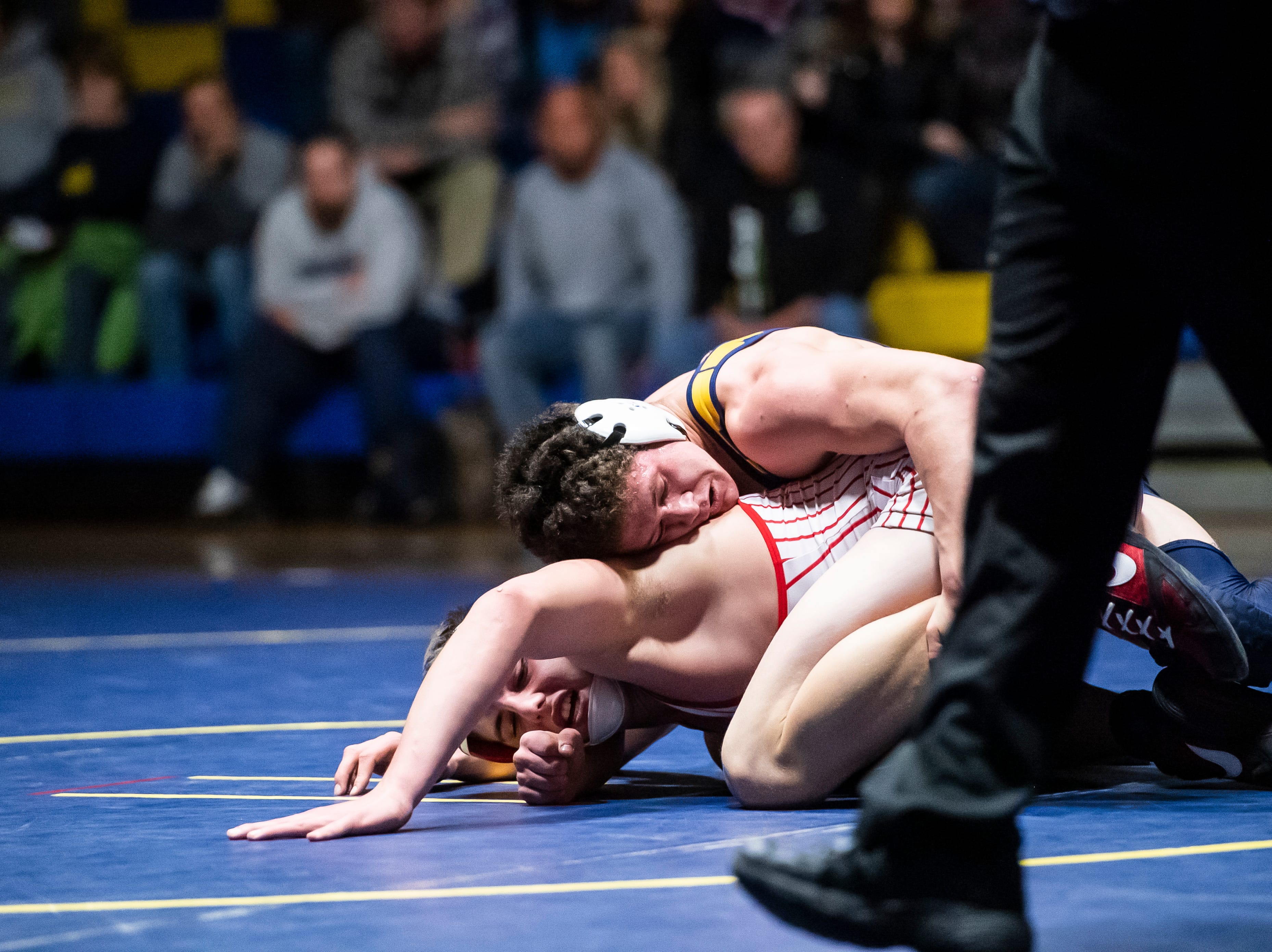 Littlestown's Jason Penton, top, wrestles Bermudian Springs' Trace Grim in the 182-pound bout on Thursday, January 24, 2019. Penton won 7-1, but the Eagles captured the YAIAA Division 3 title with a 62-12 win.