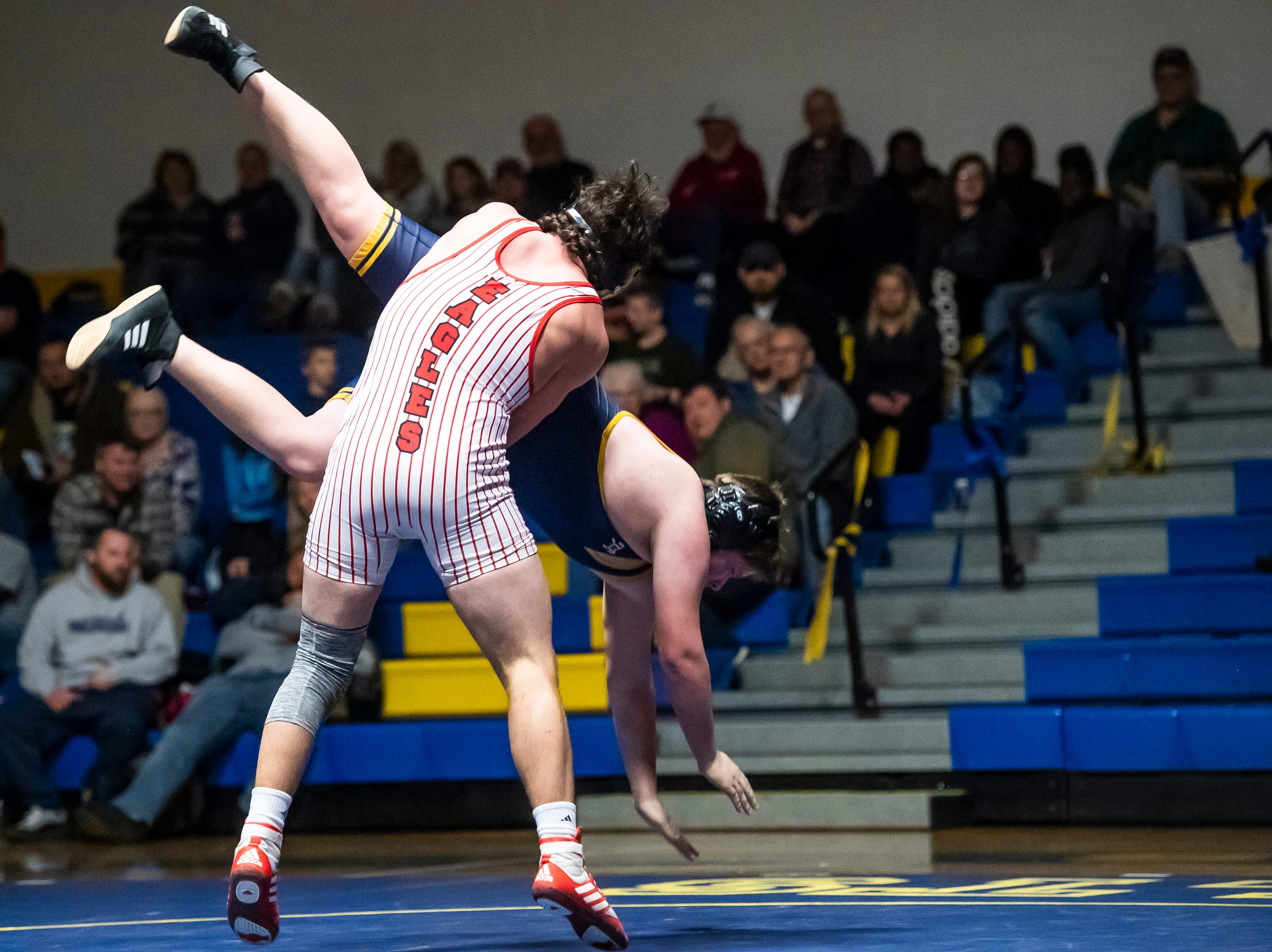 Bermudian Springs' Chase Dull throws down Littlestown's Jeremy Gebhart in the 220-pound bout on Thursday, January 24, 2019. Dull won by fall as the Eagles captured their 10th straight YAIAA Division III title with a 62-12 win.