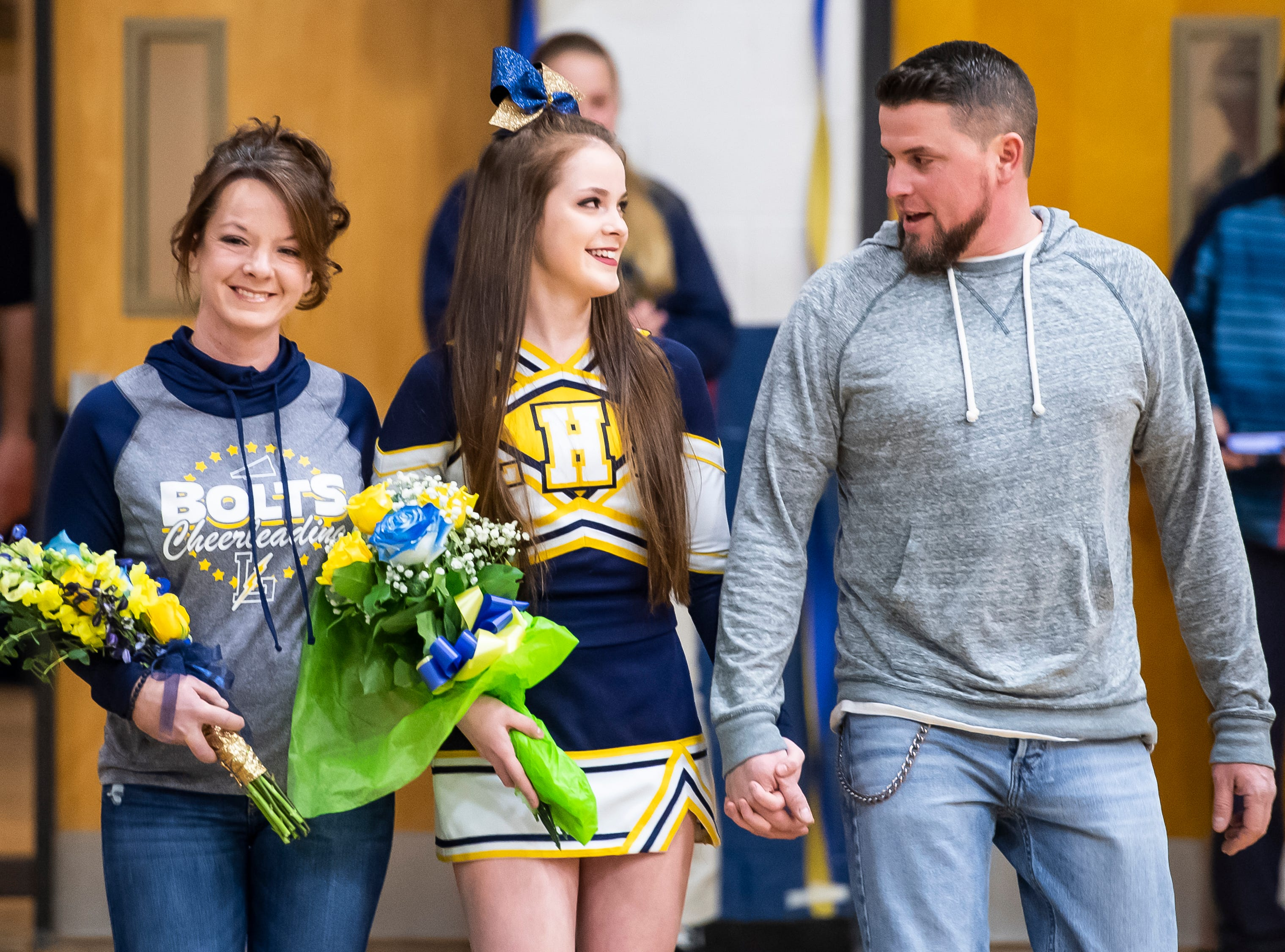 Littlestown cheerleader Jada Mummert is honored on senior night prior to a match against Bermudian Springs in Littlestown Thursday, January 24, 2019. The Bolts fell 62-12.