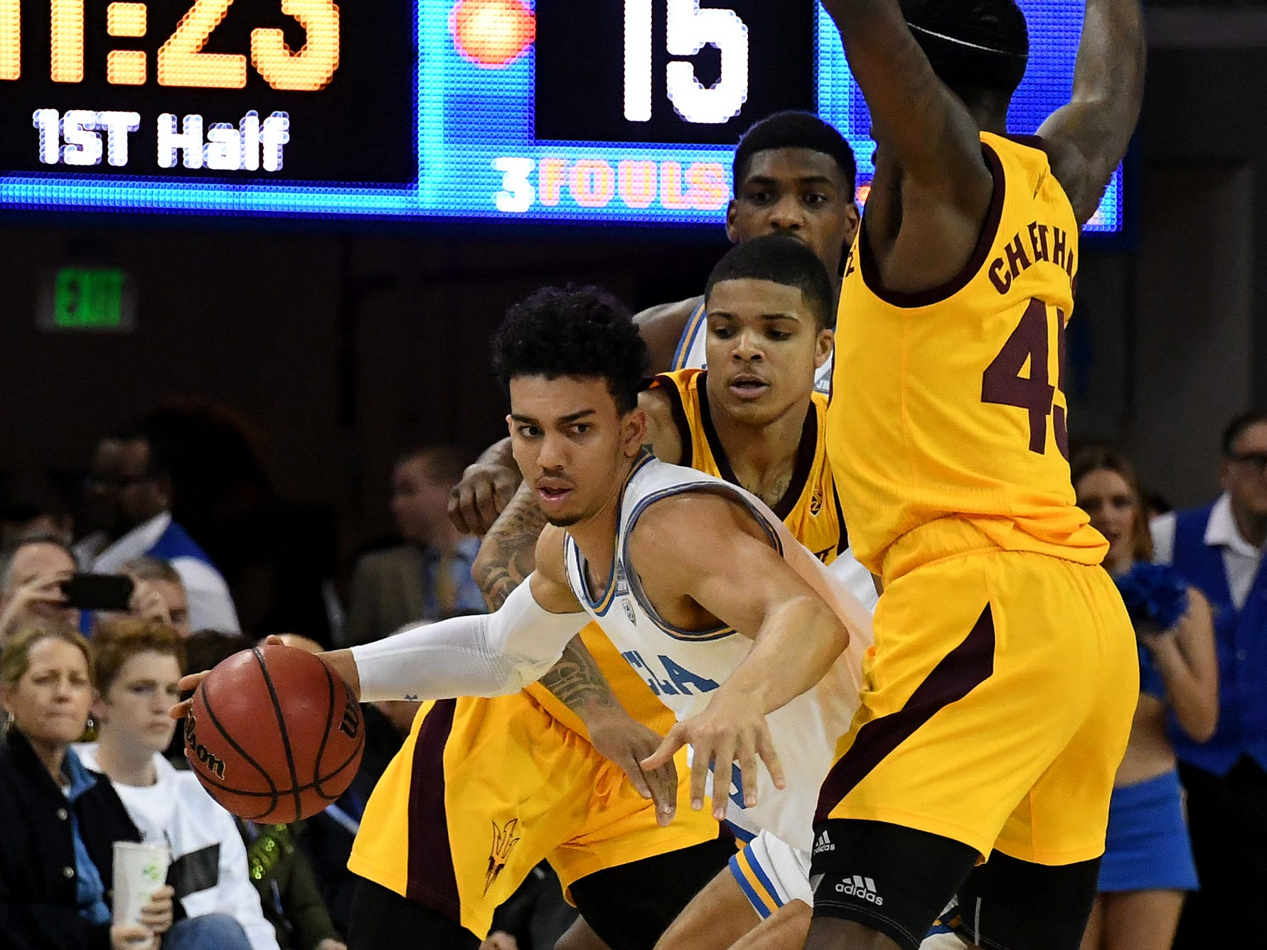 Jan 24, 2019; Los Angeles, CA, USA; UCLA Bruins guard Jules Bernard (left) tries to dribble around Arizona State Sun Devils guard Rob Edwards (middle) and forward Zylan Cheatham (45) during the first half at Pauley Pavilion. Mandatory Credit: Richard Mackson-USA TODAY Sports