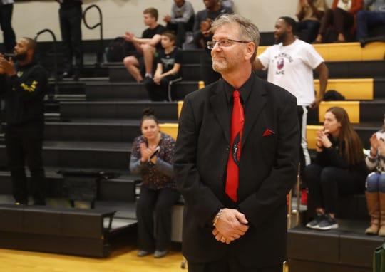 Gilbert Christian coach Kurt Keener watches a video on Jan. 2 announcing he will coach the McDonald's All-American game.