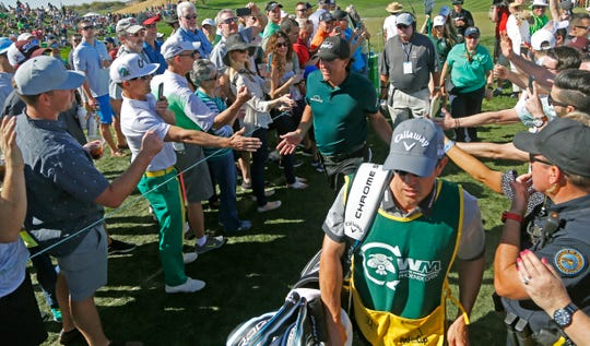 Phil Mickelson high-fives fans during the third round of the Waste Management Phoenix Open on Feb. 2, 2018 in Scottsdale, Ariz.