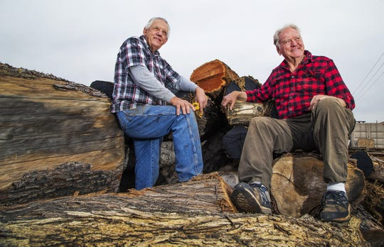 LaVor Smith, Jr. (left) and his cousin Rex Condie own and run the Wine Glass Bar Sawmill in Phoenix.