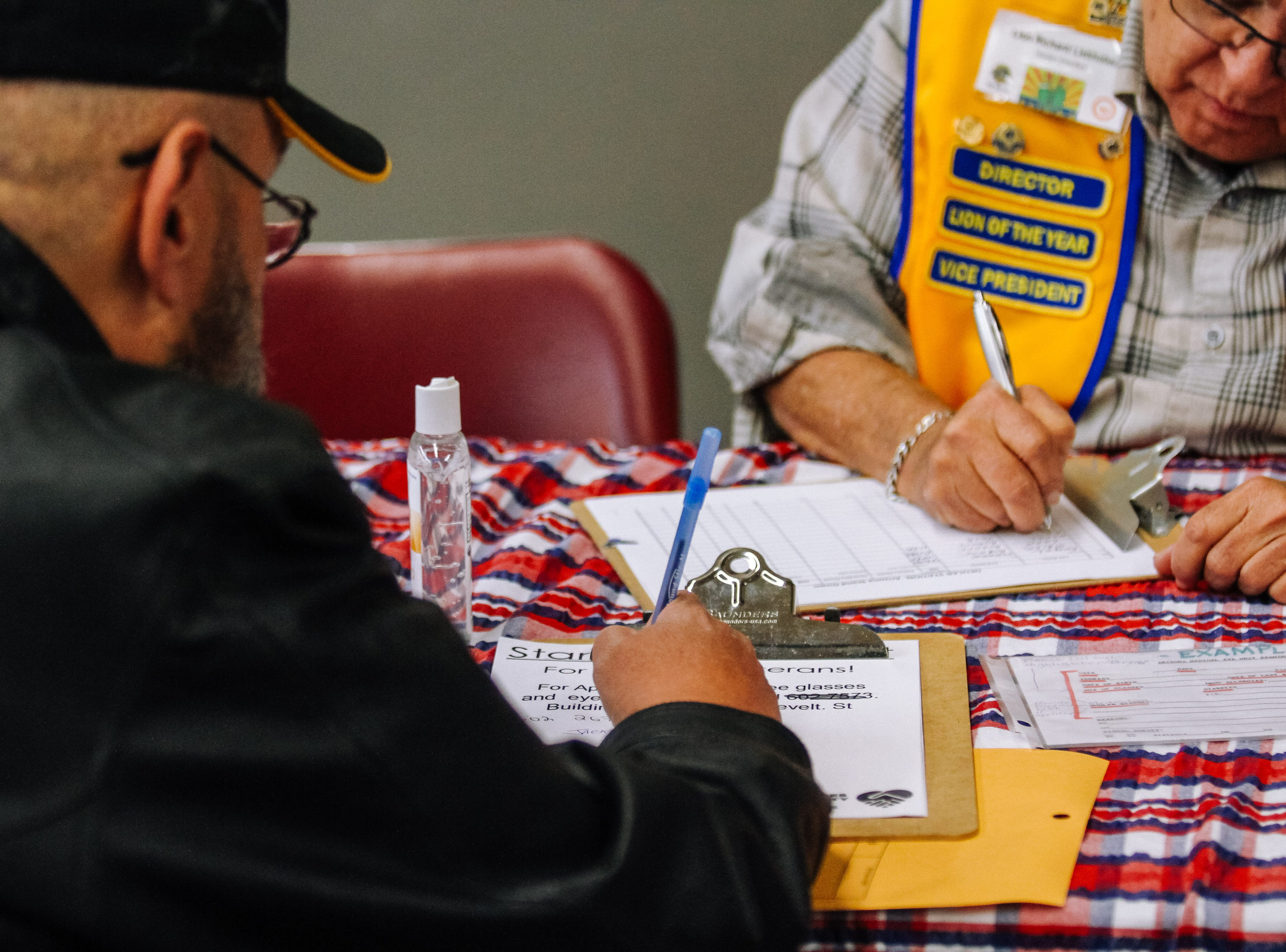 Army veteran Jack Rynes Jr. fills out forms to apply for glasses at the 2019 Veterans StandDown at the Arizona State Fairgrounds in Phoenix on Jan. 25, 2019.