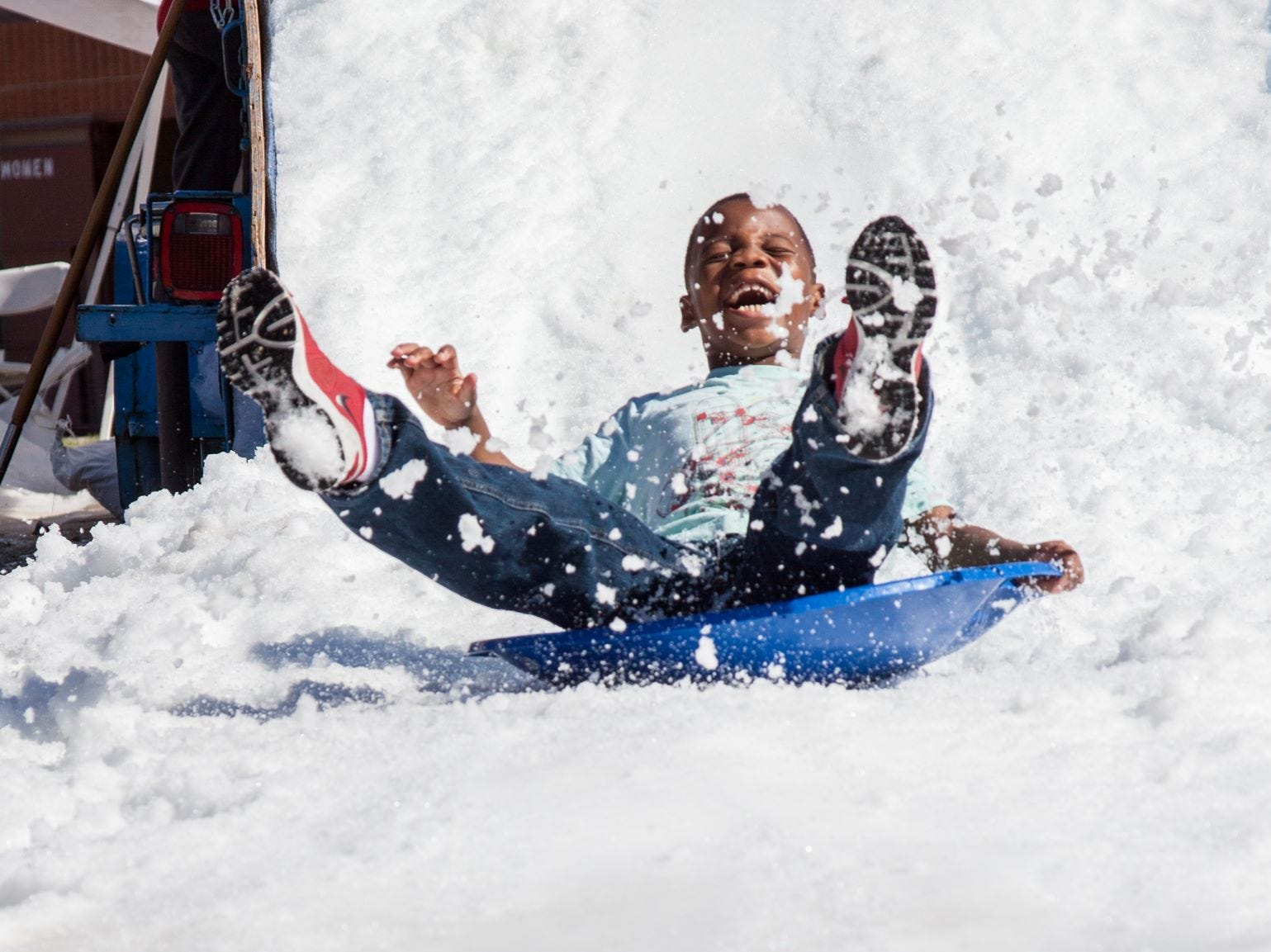 The Great Canadian Picnic offers interactive activities for families, such as a snow slide.