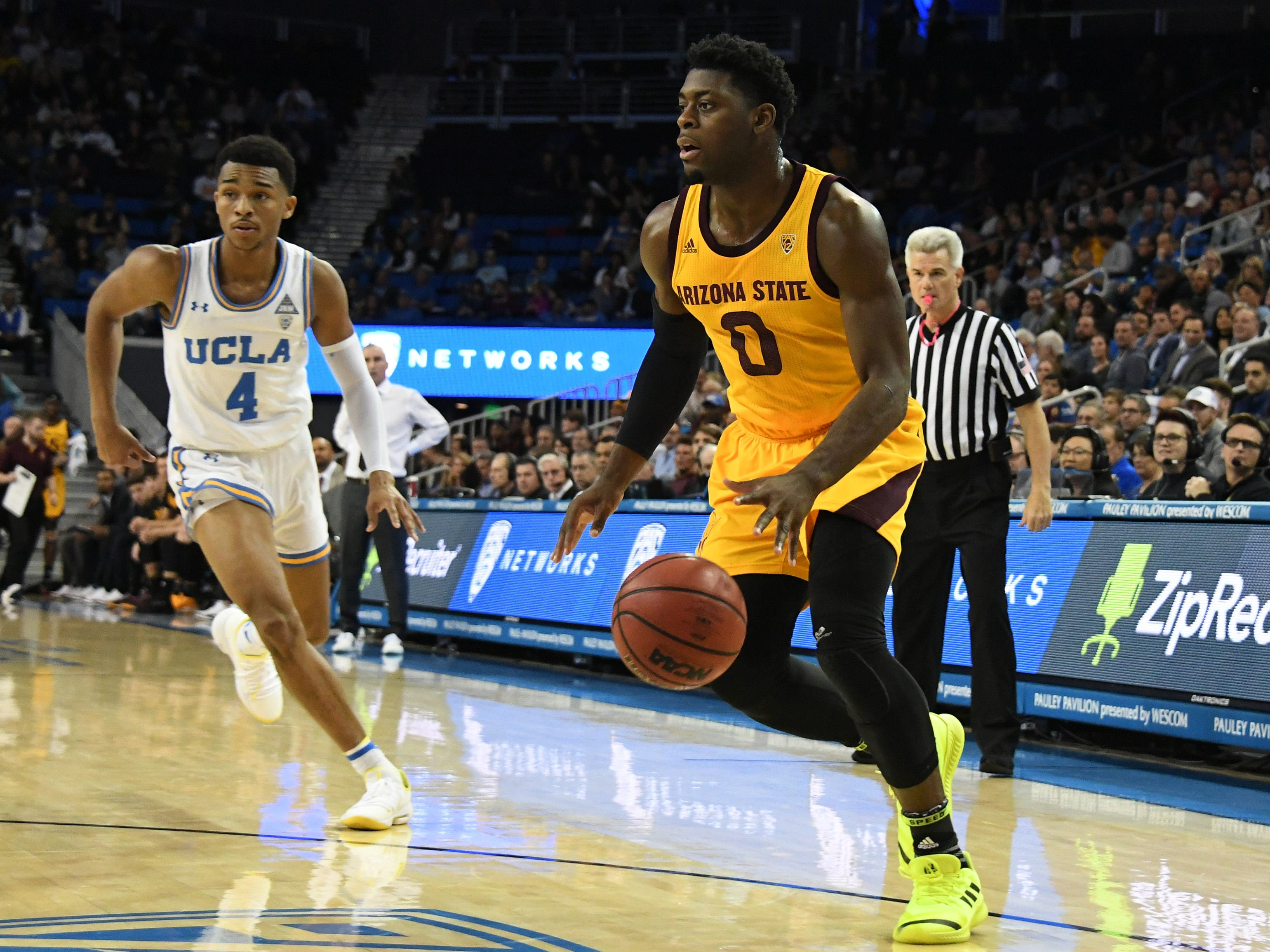 Jan 24, 2019; Los Angeles, CA, USA; Arizona State Sun Devils guard Luguentz Dort (0) dribbles to the basket against UCLA Bruins guard Jaylen Hands (4) during the first half at Pauley Pavilion. Mandatory Credit: Richard Mackson-USA TODAY Sports