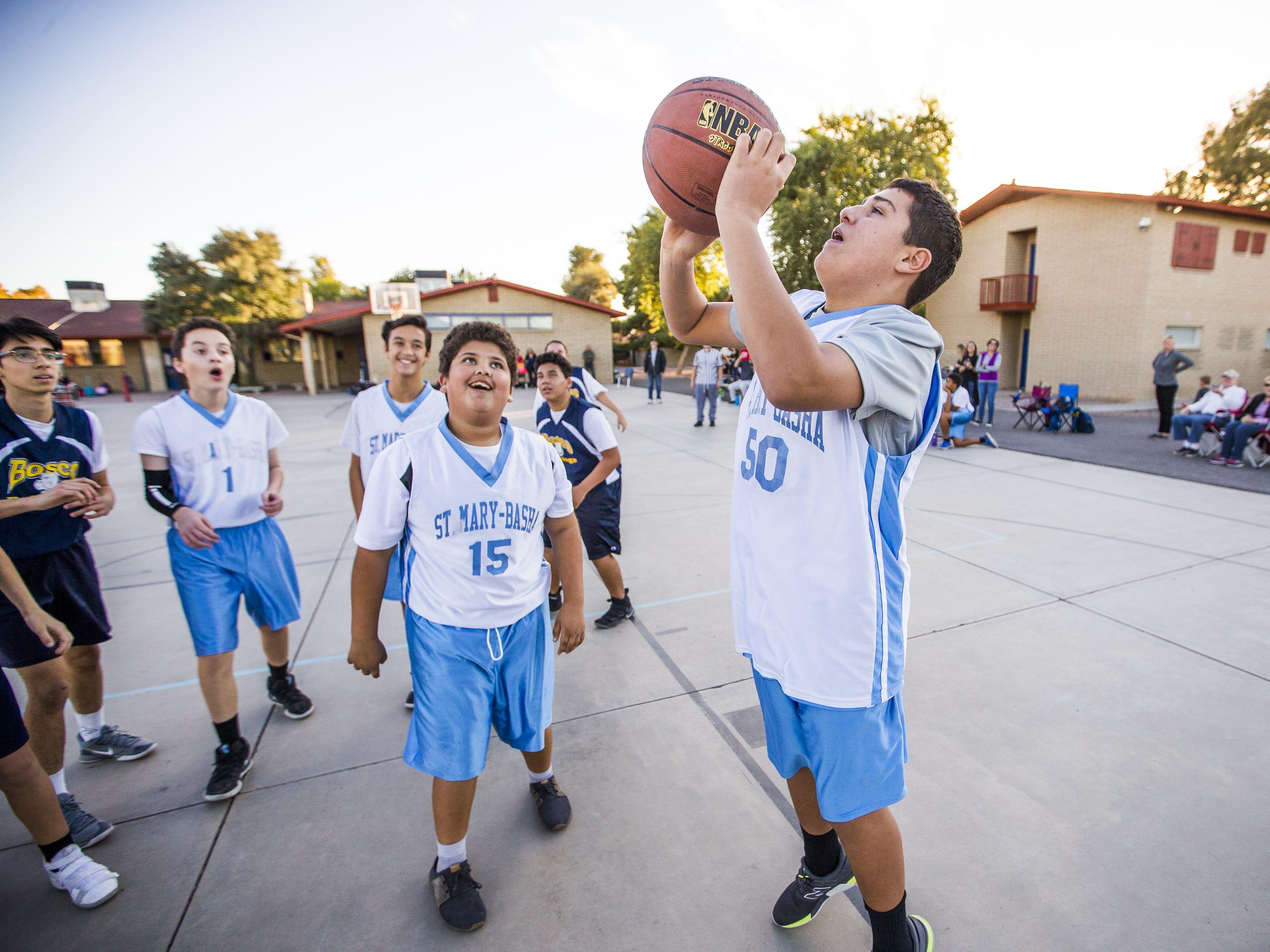 Luke Stockstad, who has autism, takes a shot on basket for his team, St. Mary-Basha Catholic School, as they play St. John Bosco, Tuesday, November 27, 2018.