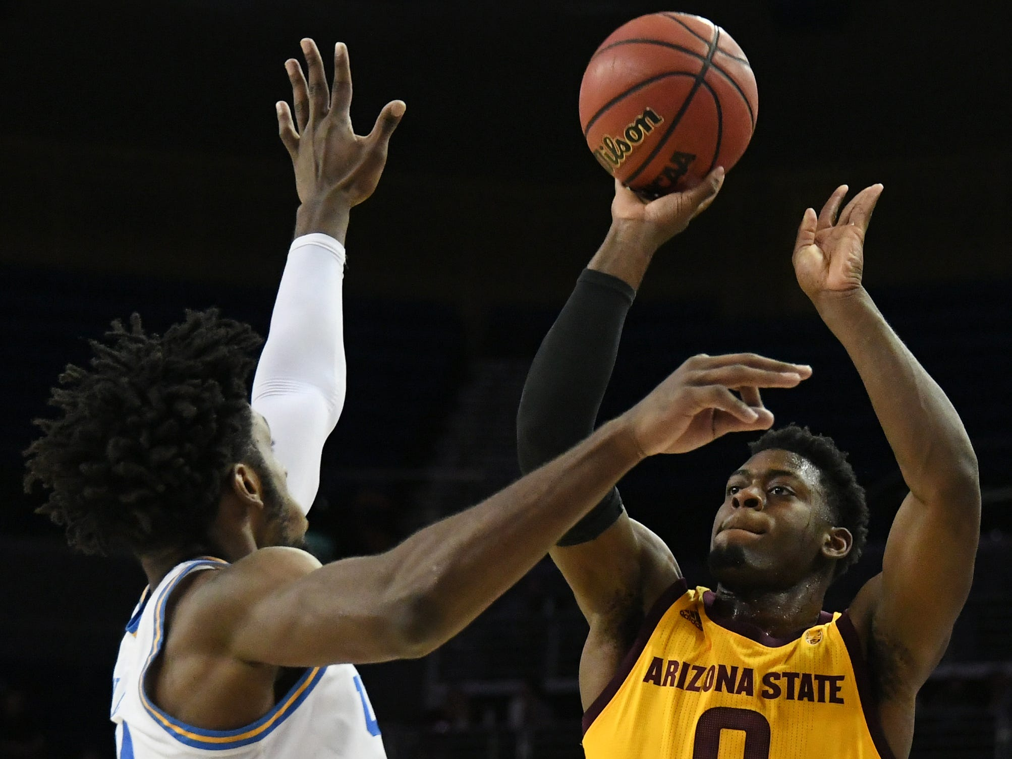 Jan 24, 2019; Los Angeles, CA, USA; Arizona State Sun Devils guard Luguentz Dort (0) shoots against UCLA Bruins guard Jalen Hill (24) during the first half at Pauley Pavilion. Mandatory Credit: Richard Mackson-USA TODAY Sports