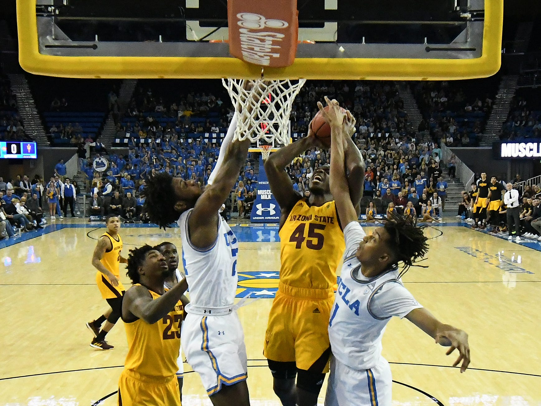 Jan 24, 2019; Los Angeles, CA, USA; Arizona State Sun Devils forward Zylan Cheatham (45) shoots between UCLA Bruins guard Jalen Hill (left) and center Moses Brown (1) during the first half at Pauley Pavilion. Mandatory Credit: Richard Mackson-USA TODAY Sports