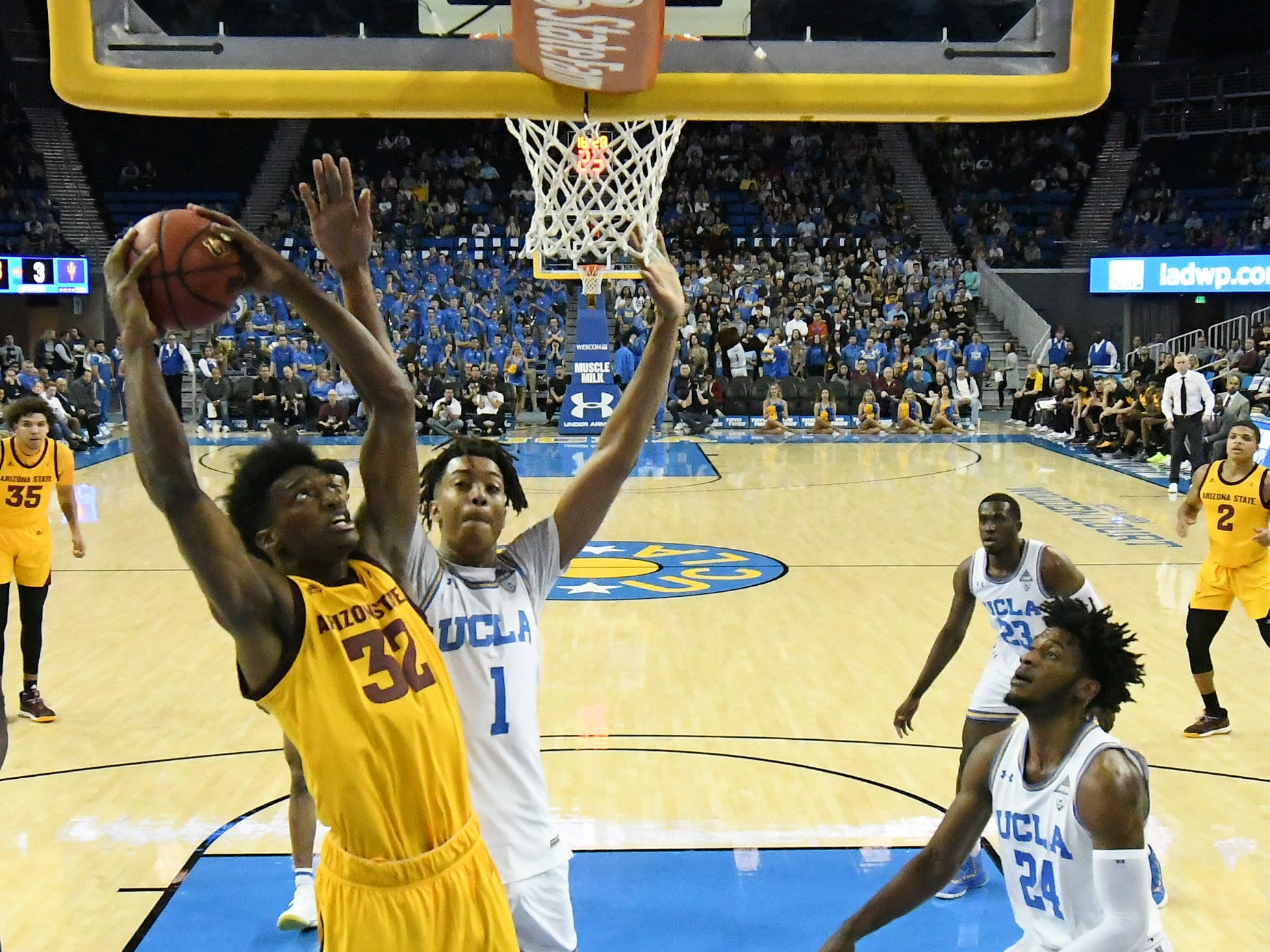 Jan 24, 2019; Los Angeles, CA, USA; Arizona State Sun Devils forward De'Quon Lake (32) shoots against UCLA Bruins center Moses Brown (1) and guard Jalen Hill (24) during the first half at Pauley Pavilion. Mandatory Credit: Richard Mackson-USA TODAY Sports