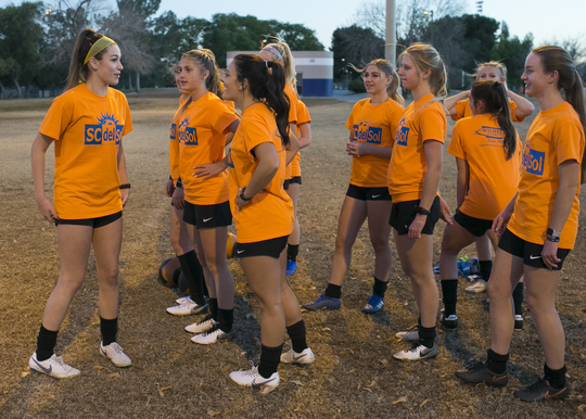 Kyle Ferry exercises before practice with the SC del Sol girls soccer club at the Rose Mofford Sports Complex on Jan. 22, 2019 in Phoenix.