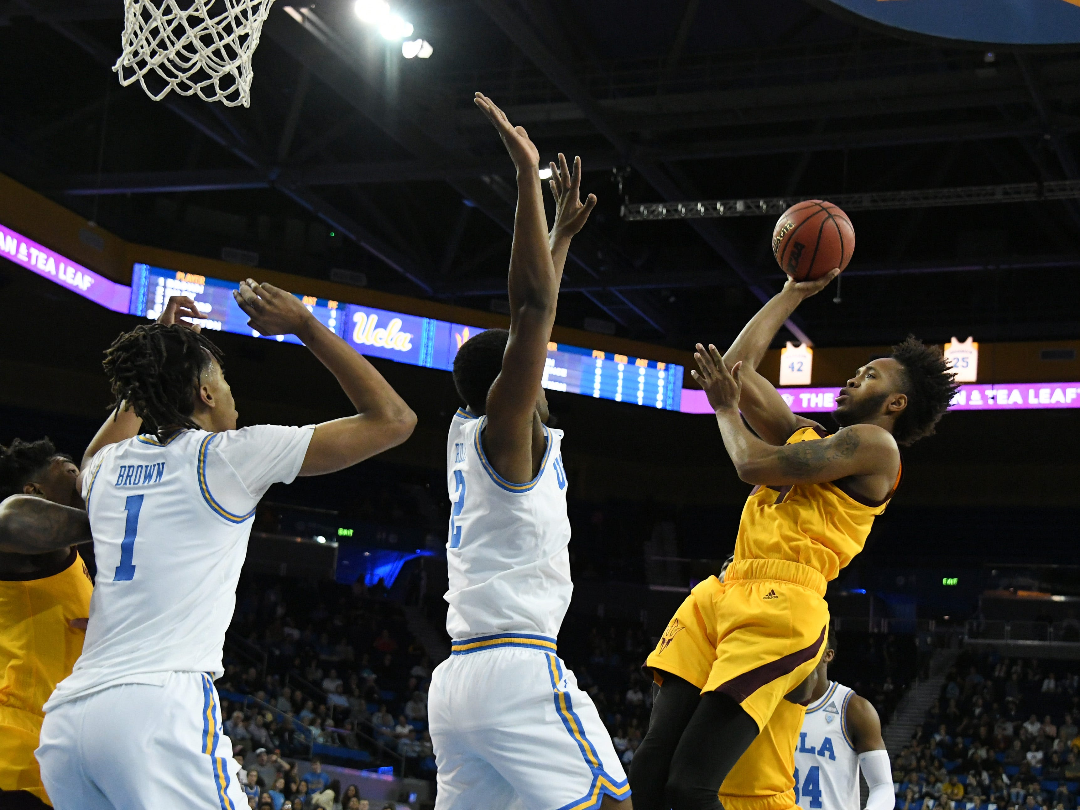 Jan 24, 2019; Los Angeles, CA, USA; Arizona State Sun Devils forward Kimani Lawrence (14) shoots over UCLA Bruins center Moses Brown (1) and forward Cody Riley (2) during the first half at Pauley Pavilion. Mandatory Credit: Richard Mackson-USA TODAY Sports