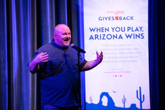 Patrick Roland tells his tale during the Arizona Storytellers New Beginnings show at the Peoria Center for the Performing Arts on  Jan. 23, 2018.