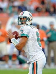 Dolphins quarterback J.P. Losman looks to throw a pass against the Eagles during the second half of a game Dec. 11, 2011.