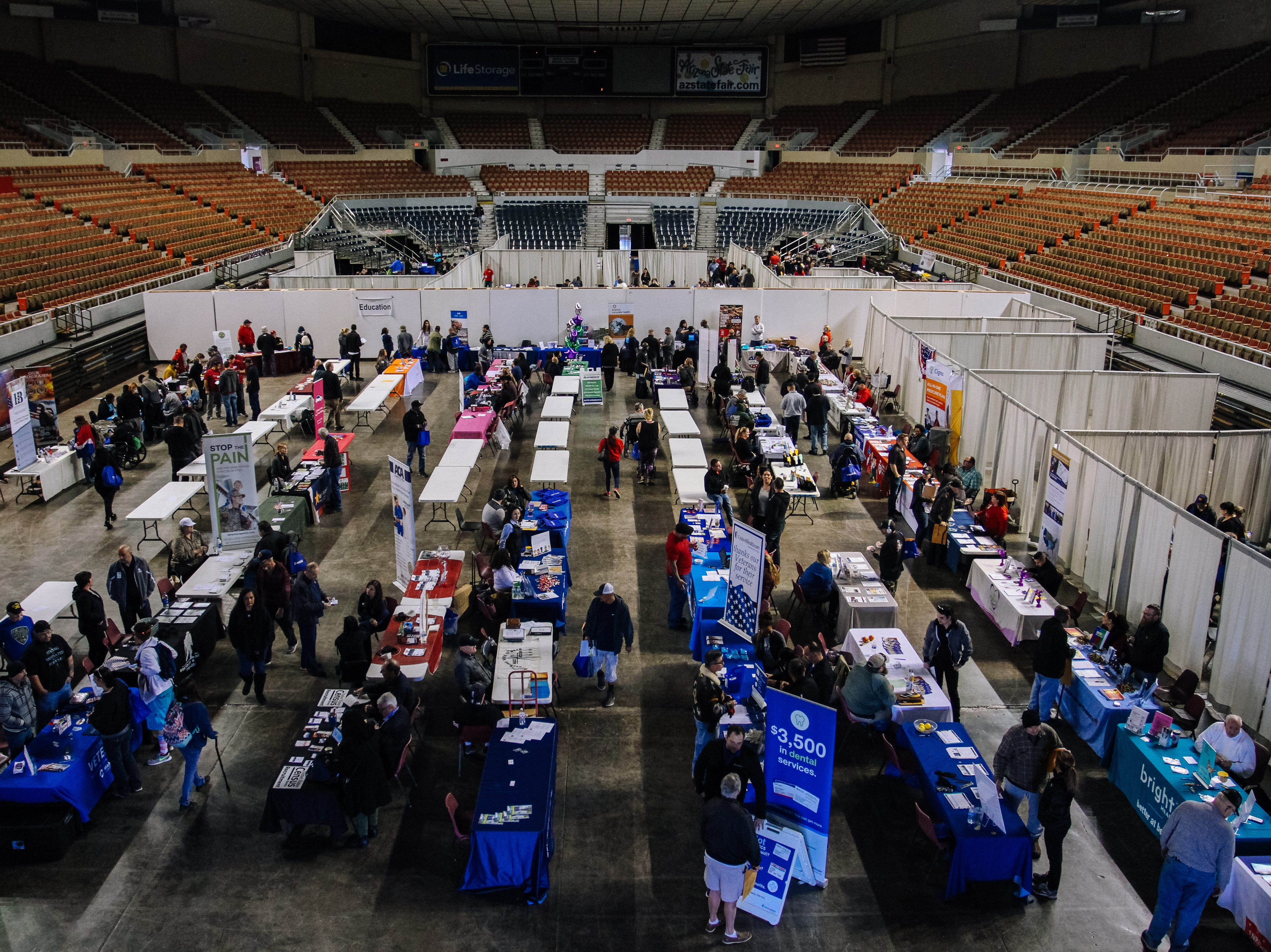 Booths and tables line the floor of the stadium the 2019 Veterans StandDown  at the Arizona State Fairgrounds in Phoenix on Jan. 25, 2019.