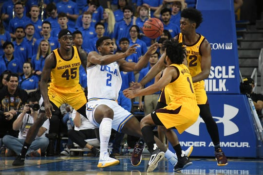 Jan 24, 2019; Los Angeles, CA, USA; UCLA Bruins forward Cody Riley (2) passes the ball against Arizona State Sun Devils forward Zylan Cheatham (45) and guard Remy Martin (1) and forward De'Quon Lake (32) during the first half at Pauley Pavilion. Mandatory Credit: Richard Mackson-USA TODAY Sports