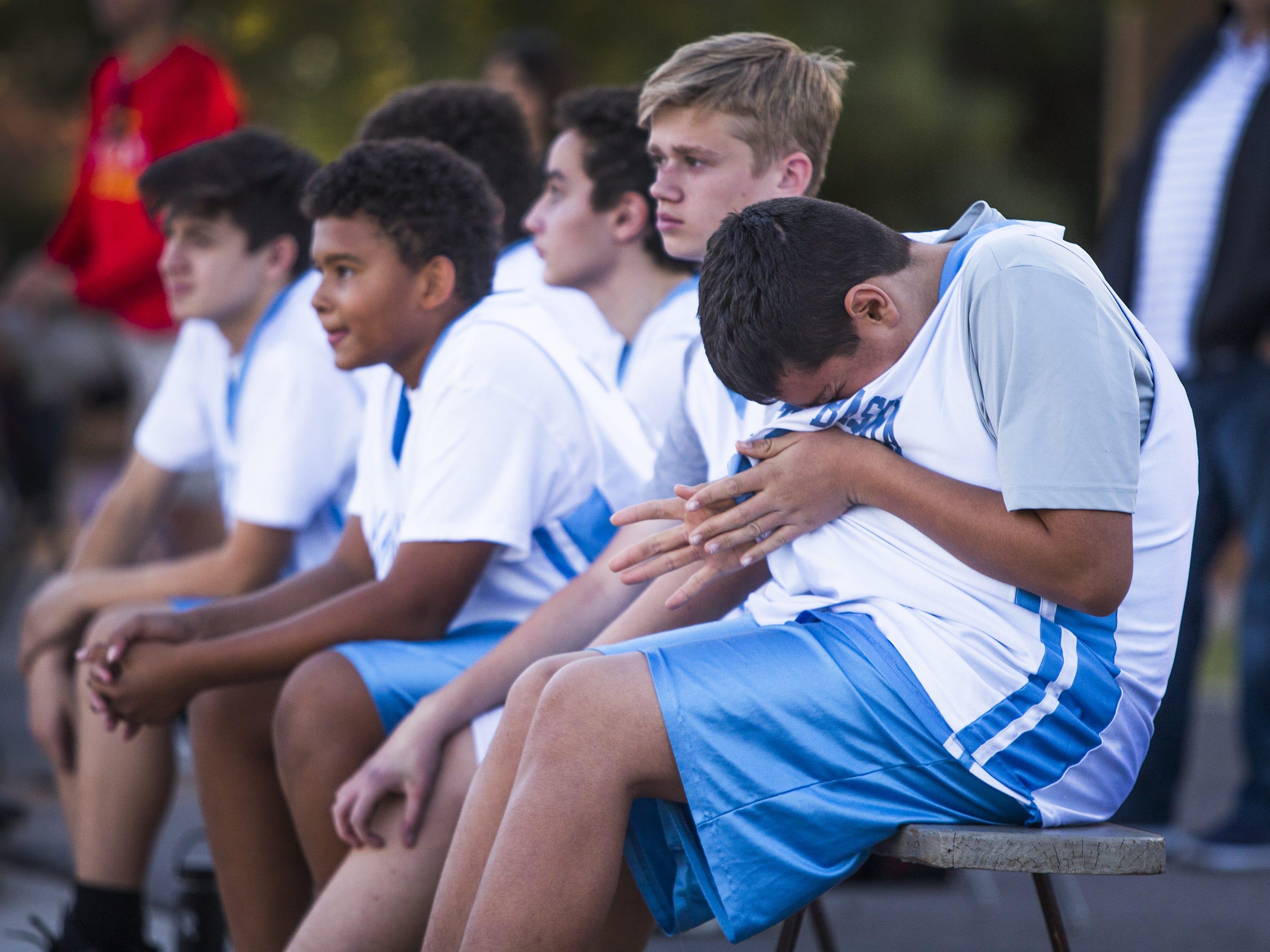 Luke Stockstad, who has autism, waits his turn to go in for his team, St. Mary-Basha Catholic School, as they play St. John Bosco, Tuesday, November 27, 2018.