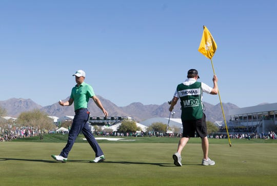 Justin Thomas walks off the 10th green during the third round of the 2018 Waste Management Phoenix Open at TPC in Scottsdale on Feb. 3, 2018.