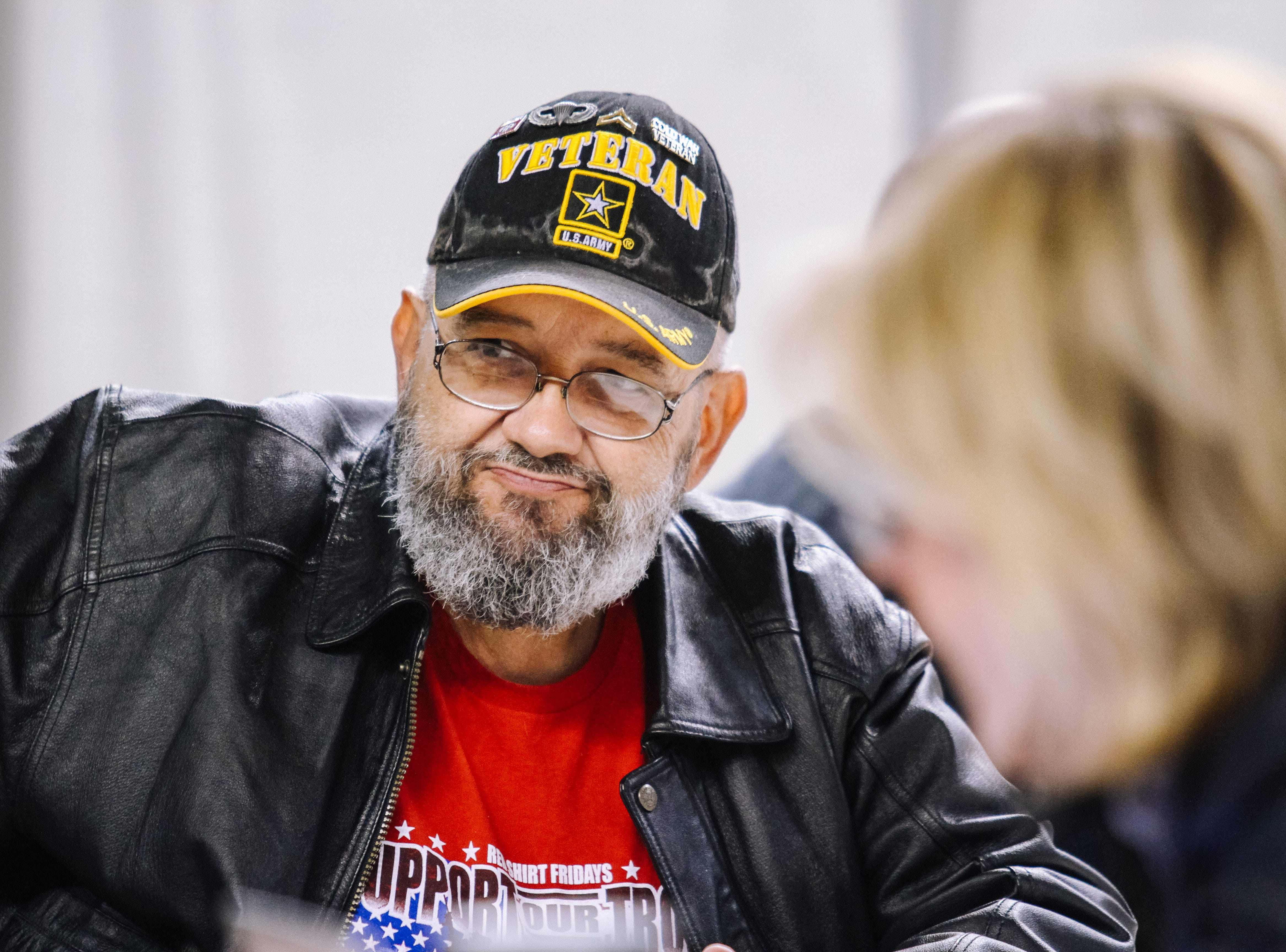 Army Veteran, Jack Rynes Jr. sits down with a volunteer at the 2019 Veterans Stand Down Event at the Arizona State Fairgrounds in Phoenix, Arizona on Friday, Jan. 25, 2019.