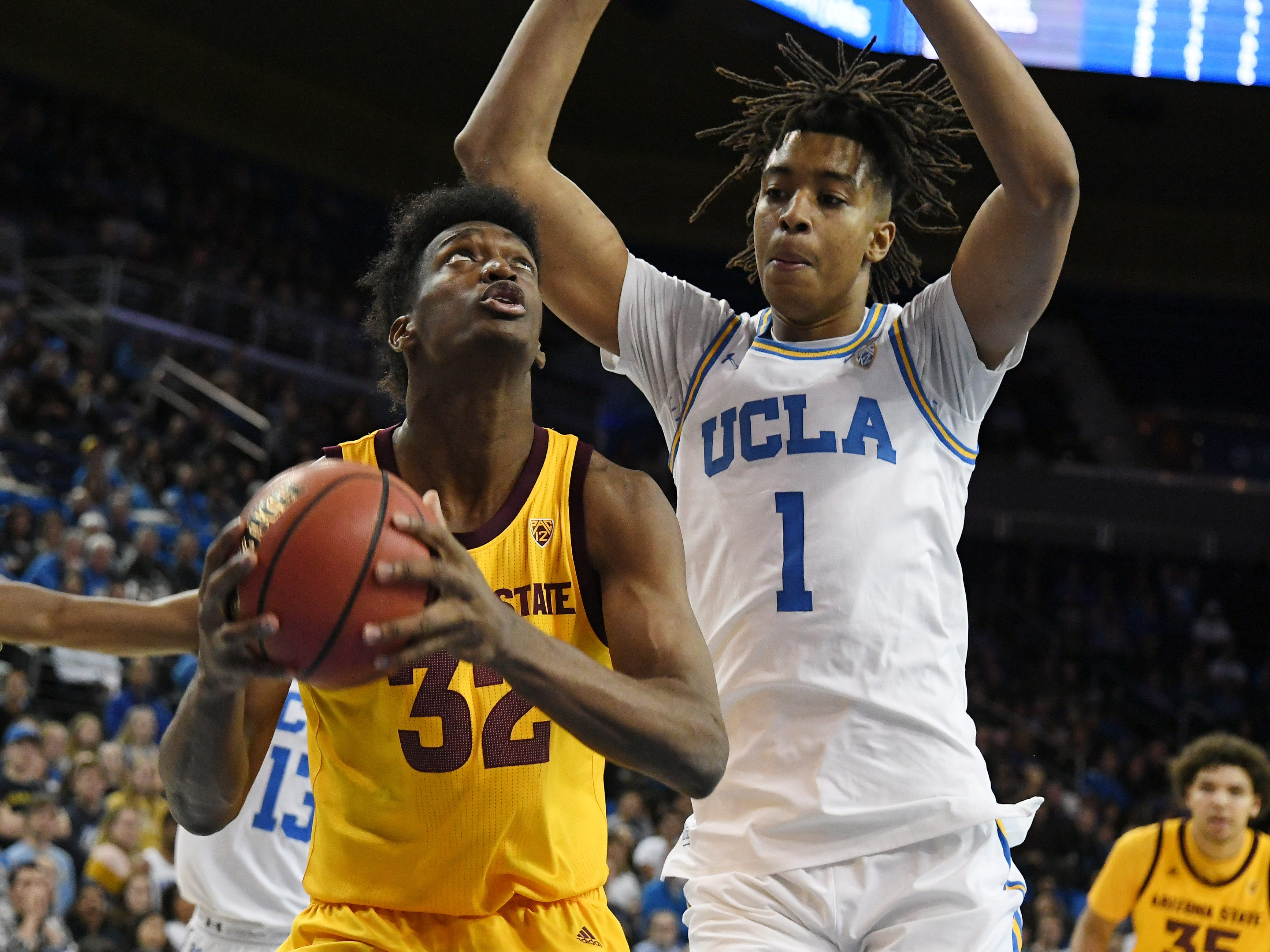 Jan 24, 2019; Los Angeles, CA, USA; Arizona State Sun Devils forward De'Quon Lake (32) shoots against UCLA Bruins center Moses Brown (1) during the first half at Pauley Pavilion. Mandatory Credit: Richard Mackson-USA TODAY Sports