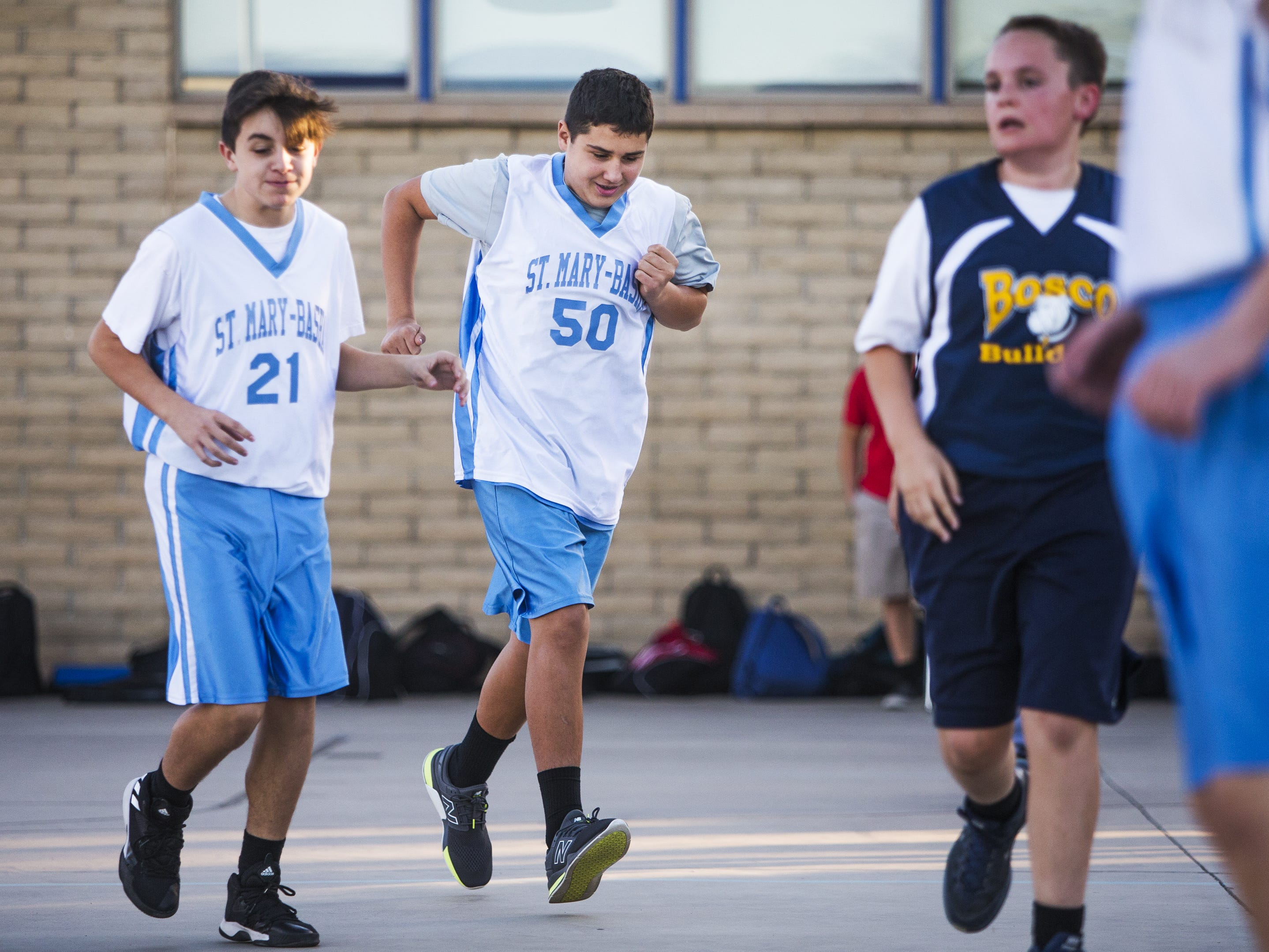 Luke Stockstad, who has autism, #50, runs downcourt for his team, St. Mary-Basha Catholic School, as they play St. John Bosco, Tuesday, November 27, 2018.