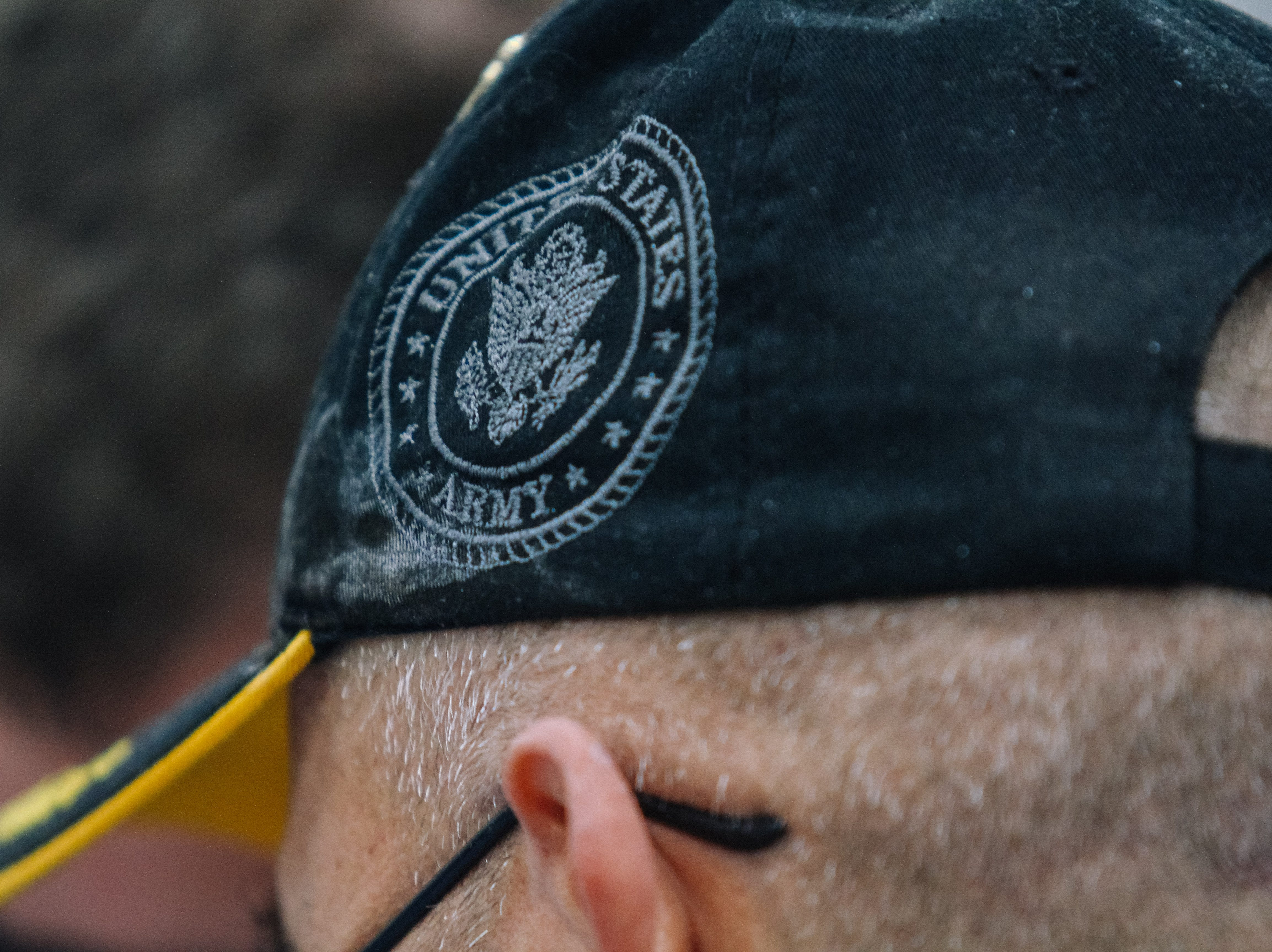 Army veteran Jack Rynes Jr. stands in line to get a new driver's license at the 2019 Veterans StandDown at the Arizona State Fairgrounds in Phoenix on  Jan. 25, 2019.