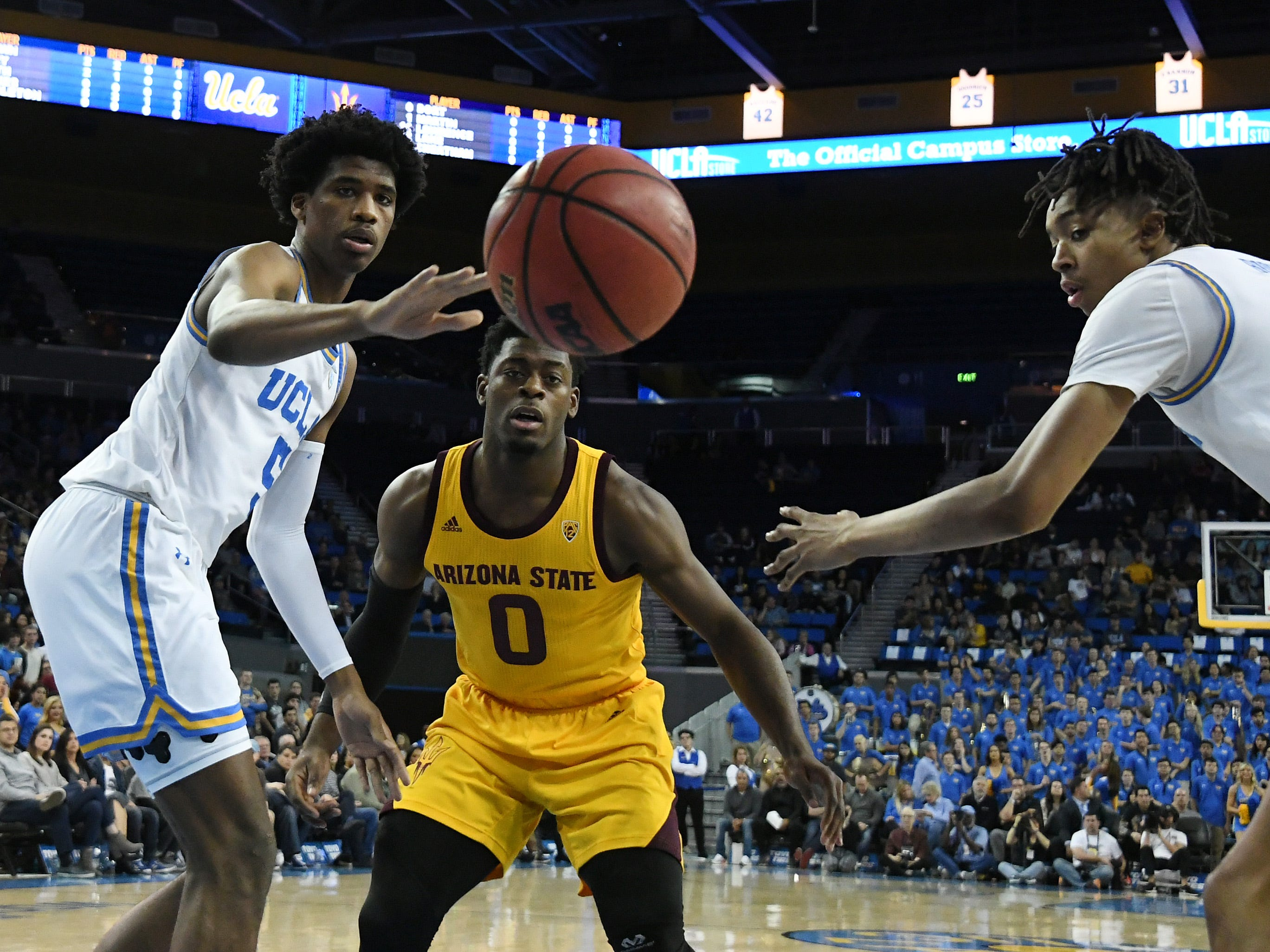 Jan 24, 2019; Los Angeles, CA, USA; UCLA Bruins guard Chris Smith (5) and center Moses Brown (1) battle Arizona State Sun Devils guard Luguentz Dort (0) as the ball bounces out of bounds during the first half at Pauley Pavilion. Mandatory Credit: Richard Mackson-USA TODAY Sports