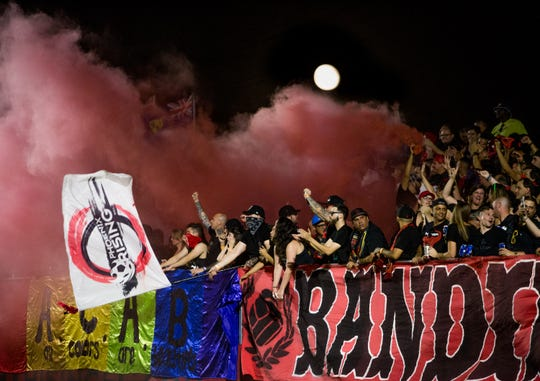 Phoenix Rising fans set off a smoke bomb and cheer on their team during a 1-0 victory over Orange County on June 29.