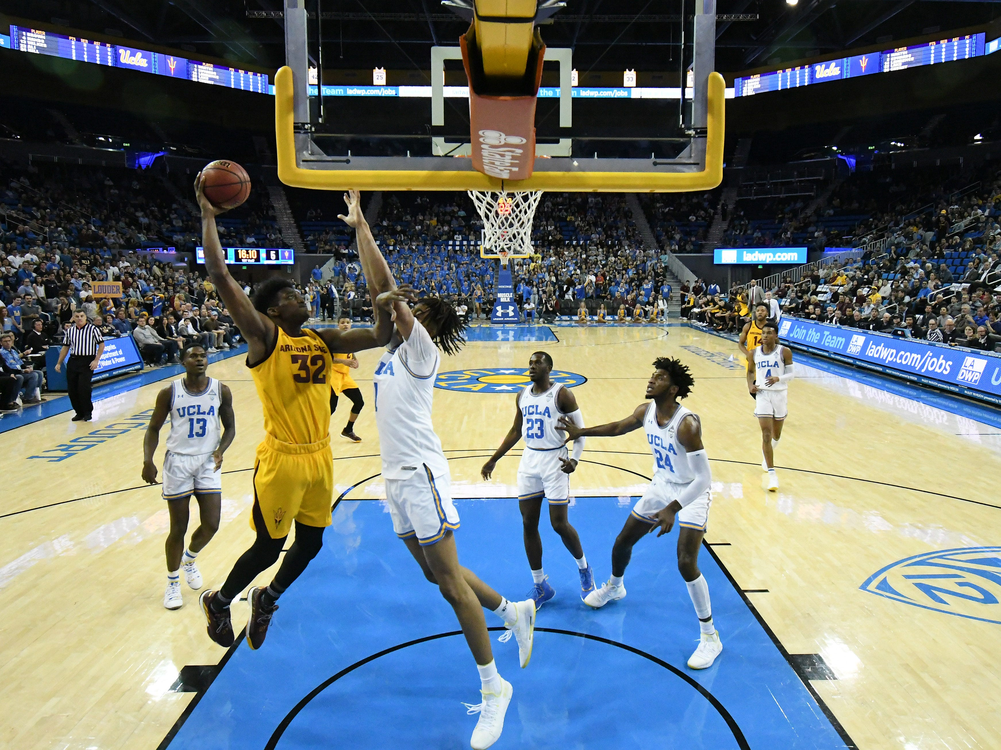 Jan 24, 2019; Los Angeles, CA, USA; Arizona State Sun Devils forward De'Quon Lake (32) dunks against UCLA Bruins center Moses Brown (1) during the first half at Pauley Pavilion. Mandatory Credit: Richard Mackson-USA TODAY Sports