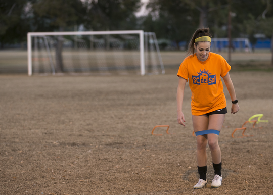 Kyla Ferry exercises before practice with the SC del Sol girls soccer club at the Rose Mofford Sports Complex on Jan. 22, 2019 in Phoenix.