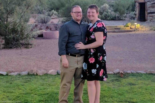 Russell Toomey, a professor at the University of Arizona, is suing the state over a lack of coverage for transgender health care. Russ, left, is pictured here with his wife, Danielle Flink.