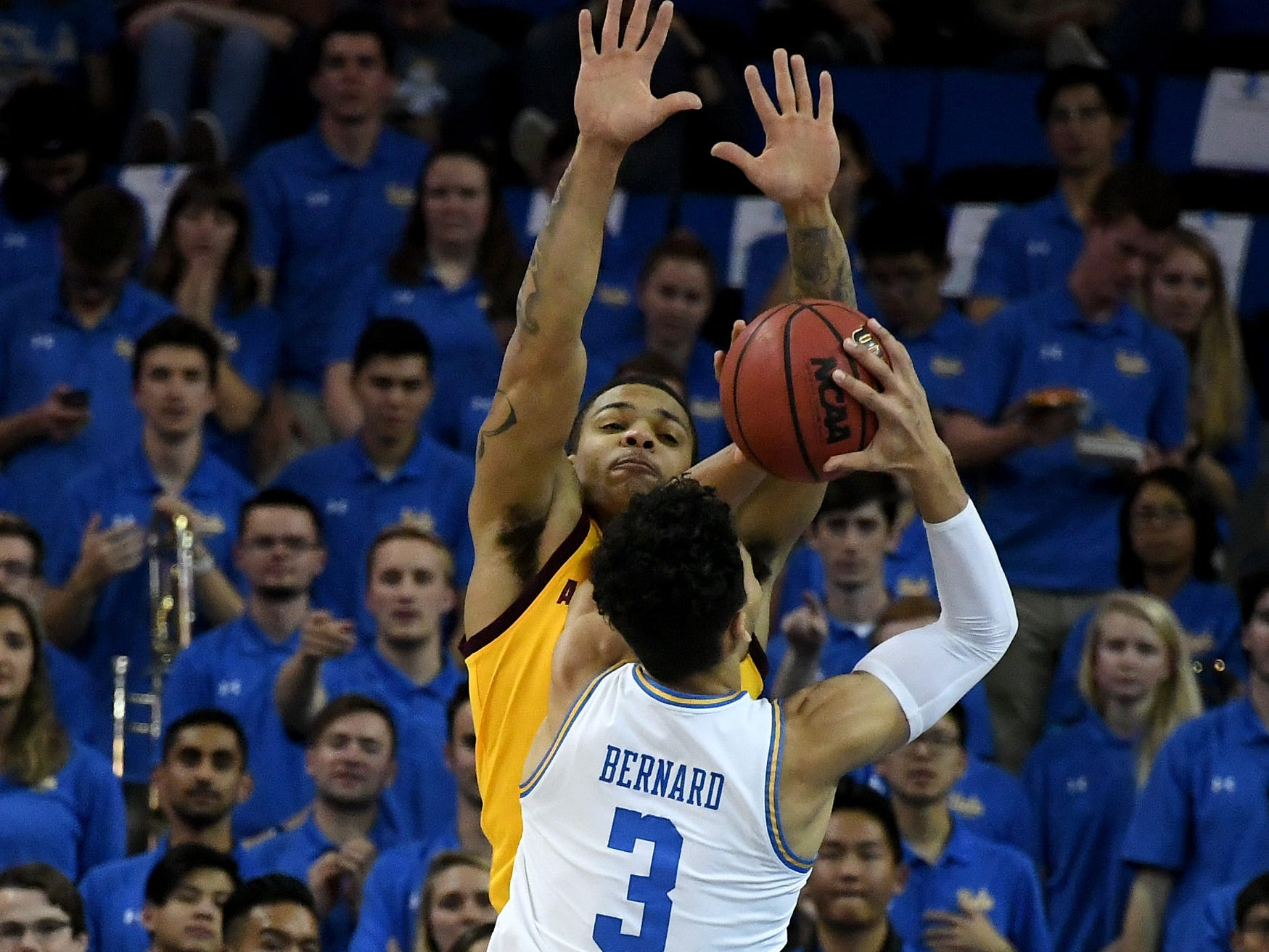 Jan 24, 2019; Los Angeles, CA, USA; UCLA Bruins guard Jules Bernard (3) shoots against Arizona State Sun Devils guard Rob Edwards (facing camera) during the first half at Pauley Pavilion. Mandatory Credit: Richard Mackson-USA TODAY Sports