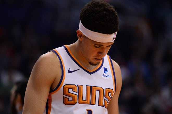 Devin Booker looks on during the second half of a game against the Trail Blazers on Jan. 24 at Talking Stick Resort Arena.