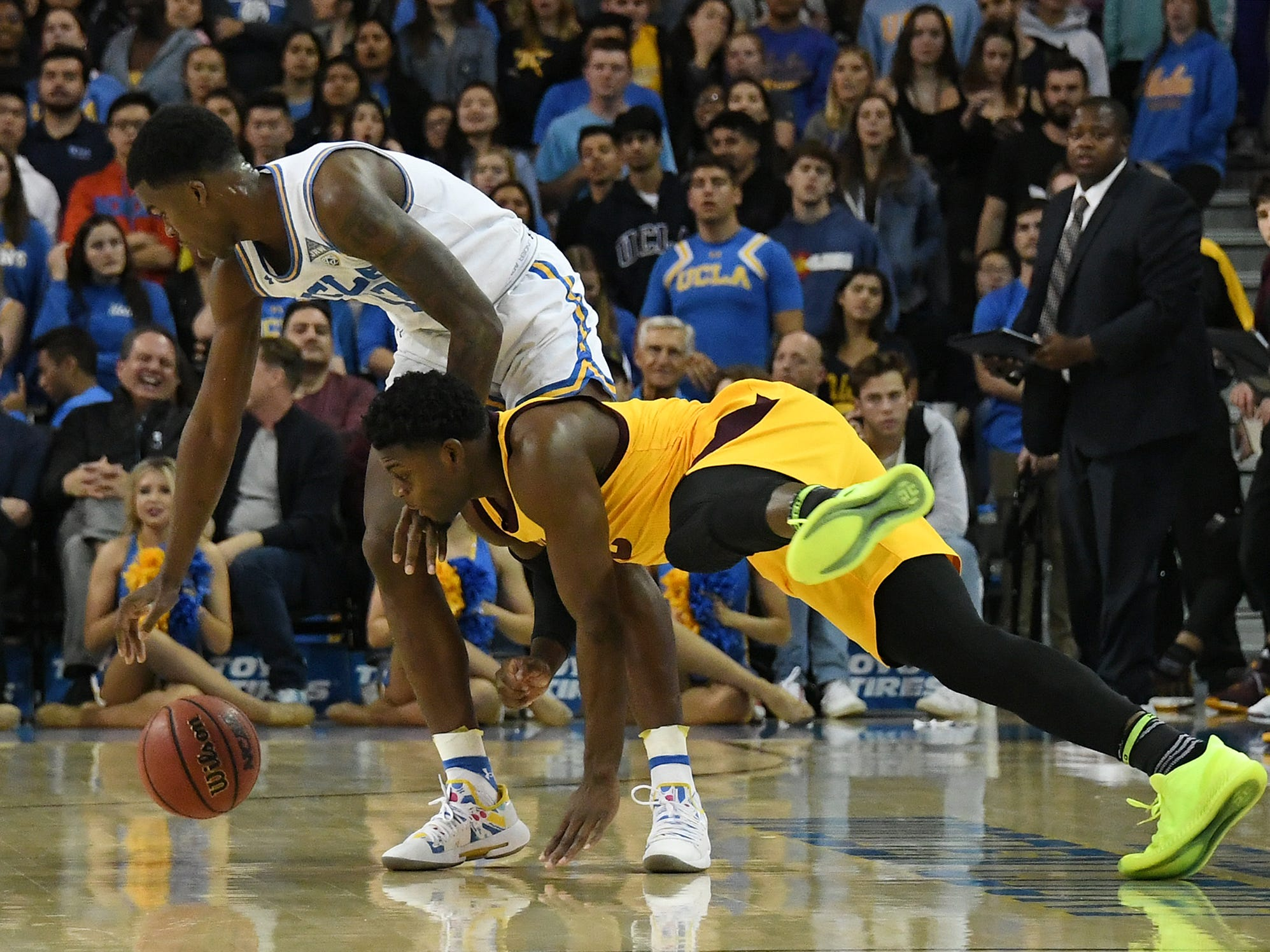 Jan 24, 2019; Los Angeles, CA, USA; UCLA Bruins guard Kris Wilkes (13) and Arizona State Sun Devils guard Luguentz Dort (0) chase a loose ball during the first half at Pauley Pavilion. Mandatory Credit: Richard Mackson-USA TODAY Sports