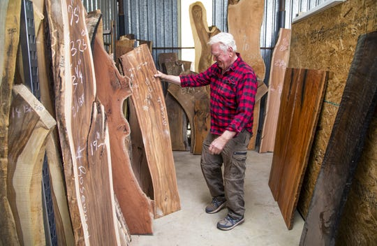 Rex Condie looks over some lumber at the Wine Glass Bar Sawmill in Phoenix.