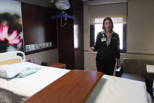 Pam Jensen, ProMedica Memorial Hospital's president, shows off a new Acute Care room for patients in intensive care.
