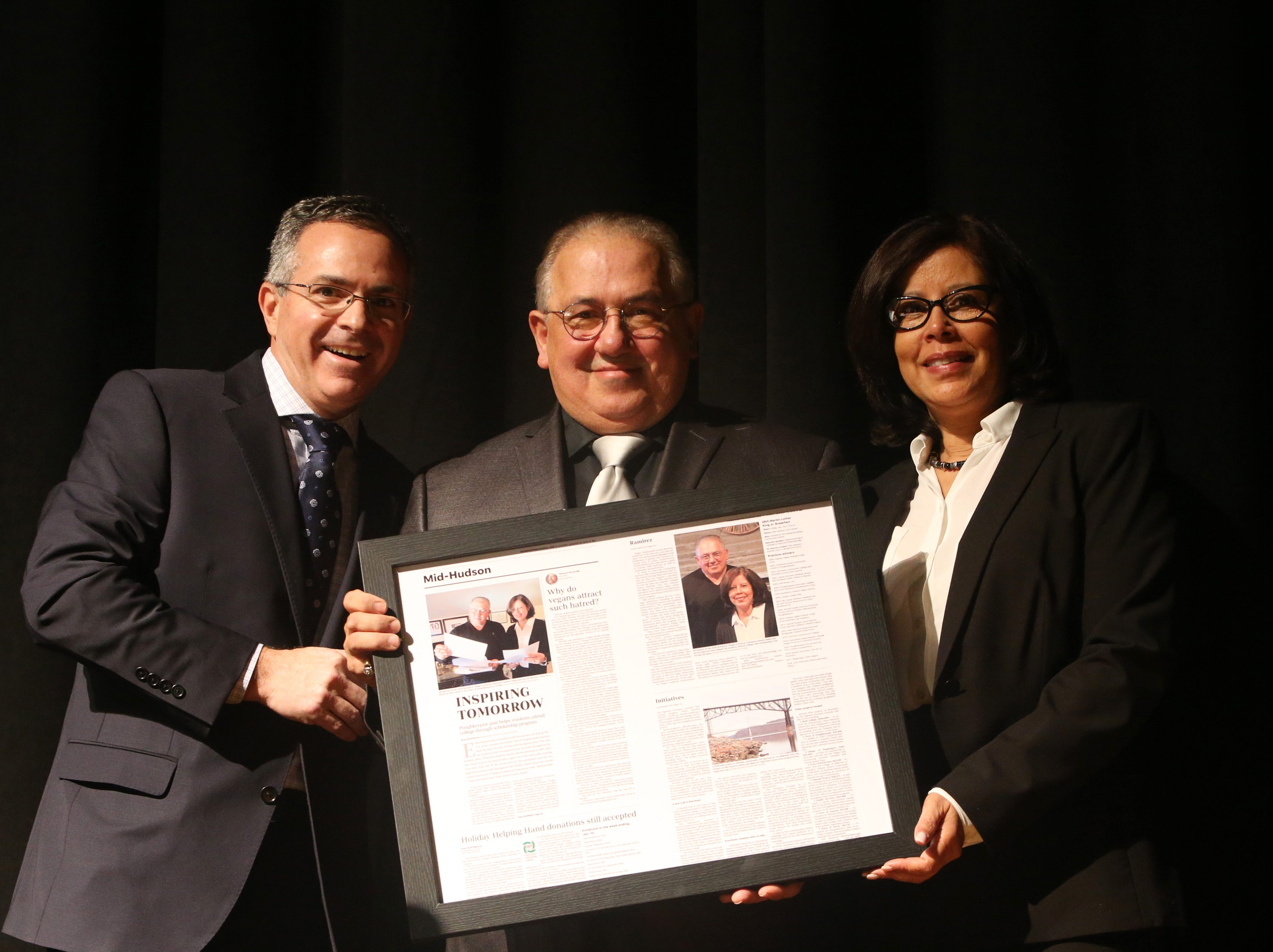 Poughkeepsie Journal Media president Jim Fogler presents Eddie and Norma Ramirez with the Richard K. Wager Inclusive Champion Award during the Martin Luther King Jr. Breakfast in the City of Poughkeepsie on January 25, 2019.